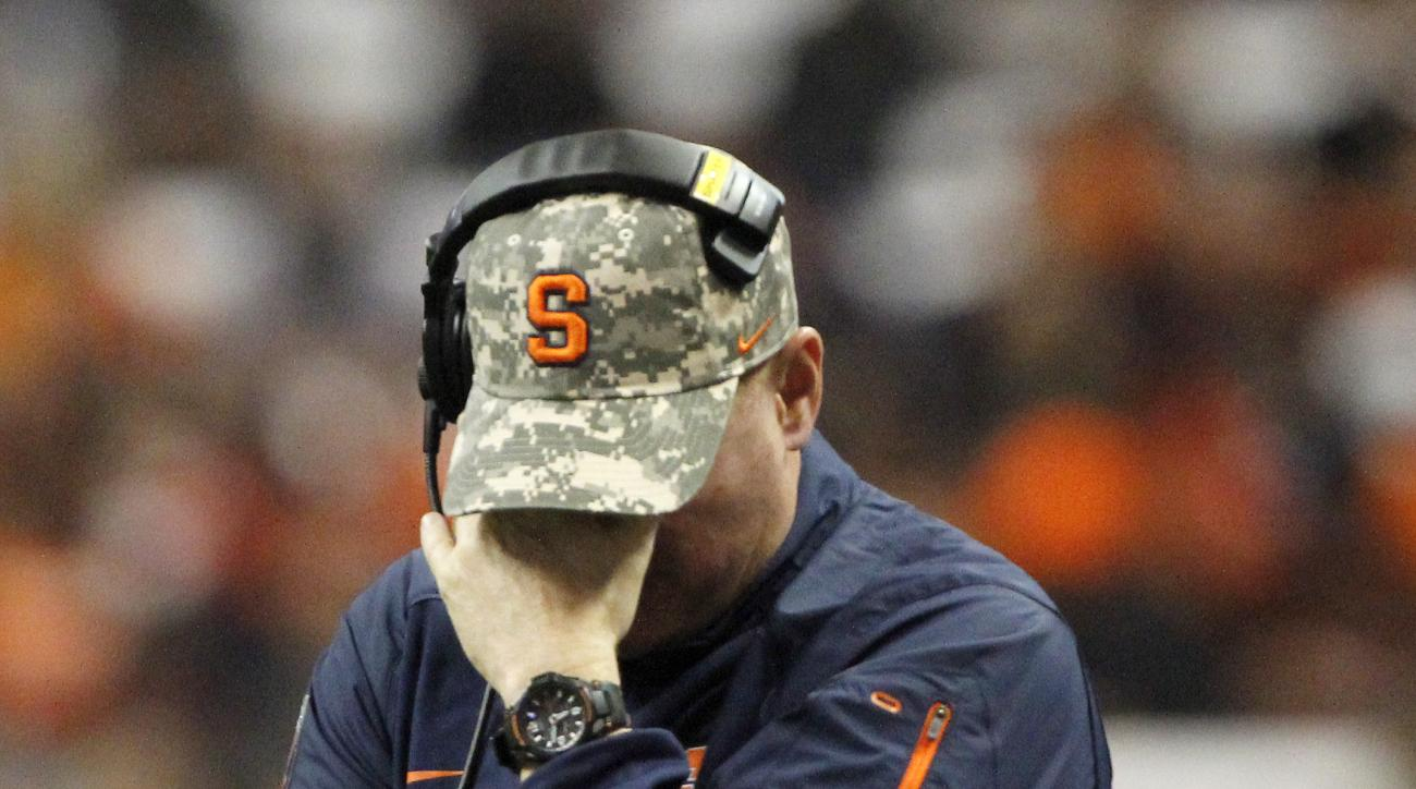 FILE - In this Nov. 14, 2015, file photo, Syracuse head coach Scott Shafer reacts during a timeout in the fourth quarter of an NCAA college football game against Clemson, in Syracuse, N.Y. Syracuse has fired football coach Scott Shafer two days after the