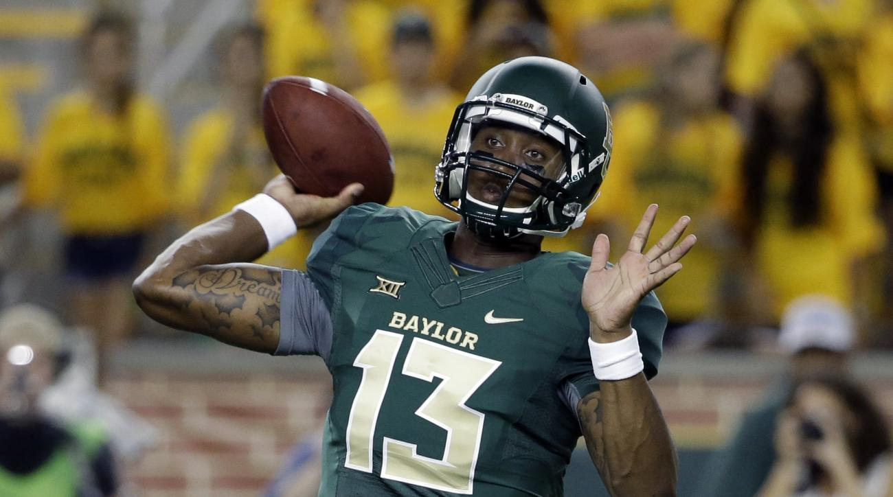 FILE - In this Saturday, Sept. 6, 2014, file photo, Baylor quarterback Chris Johnson (13) passes in the second half of an NCAA college football game against Northwestern State in Waco, Texas. Johnson is getting ready to become the third starting quarterba