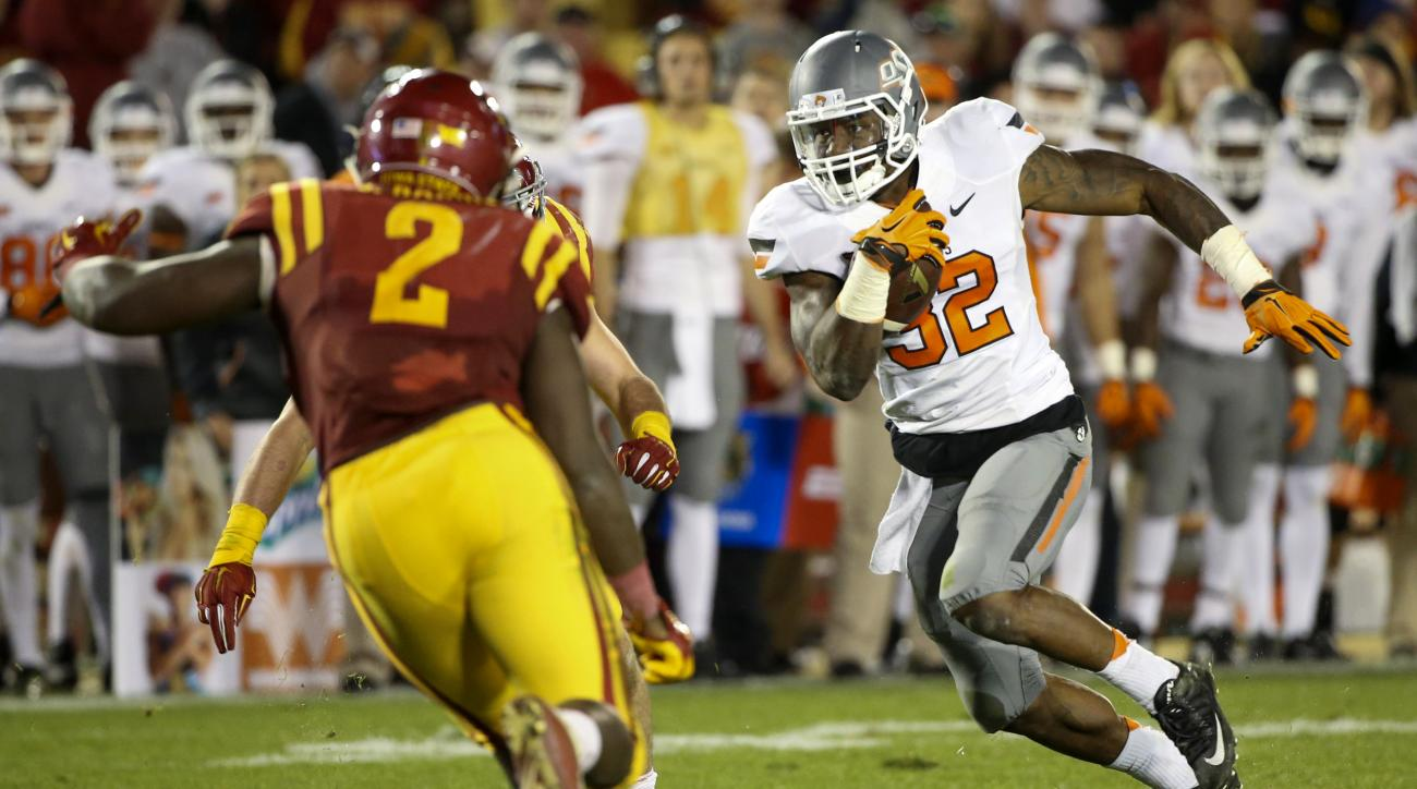 FILE - In this Saturday, Nov. 14, 2015, file photo, Oklahoma State running back Chris Carson, right, carry the ball during the second half of an NCAA college football game against Iowa State in Ames, Iowa. Oklahoma State plays Oklahoma on Saturday, Nov. 2