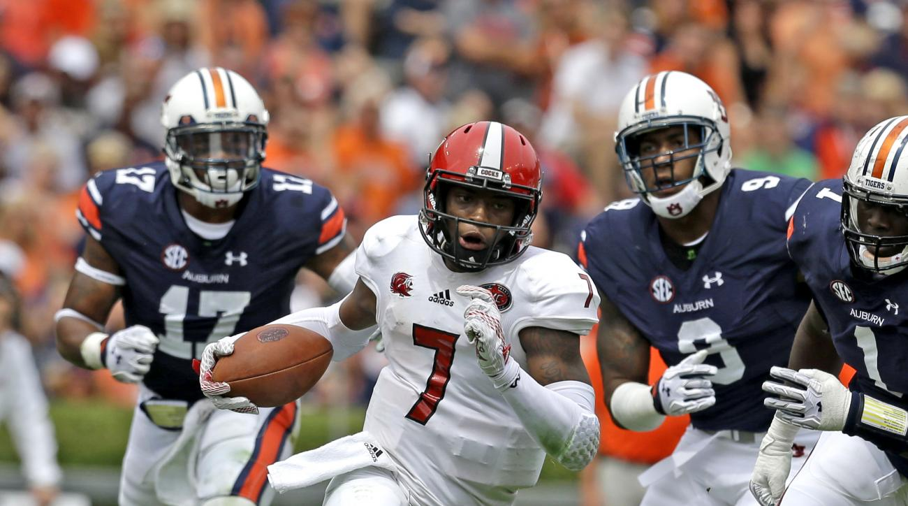 FILE - In this Sept. 12, 2015, file photo, Jacksonville State quarterback Eli Jenkins (7) scrambles for a first down during the second half of an NCAA college football game against Auburn, in Auburn, Ala. Quarterback Eli Jenkins and his teammates can't he