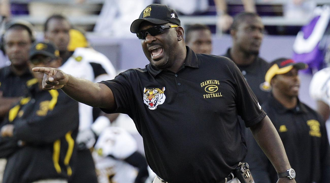 FILE - In this Sept. 8, 2012, file photo, Grambling State head coach Doug Williams yells from the sideline during the first half of an NCAA college football game against TCU in Fort Worth, Texas. Grambling State announced Wednesday, Sept. 11, 2013, that t