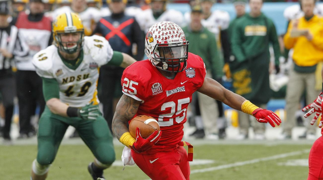Illinois State running back Marshaun Coprich (25) carries the ball against North Dakota State during the FCS Championship NCAA college football game Saturday, Jan. 10, 2015, in Frisco, Texas.   North Dakota State won the game 29-27 for their fourth straig