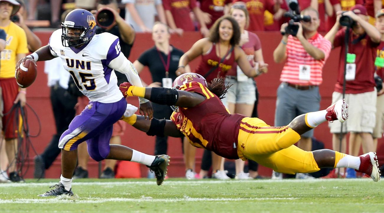 Northern Iowa quarterback Justin Black gets away from a diving Iowa State defensive lineman Demond Tucker during the first half of an NCAA college football game, Saturday, Sept. 5, 2015, in Ames, Iowa. (AP Photo/Justin Hayworth)