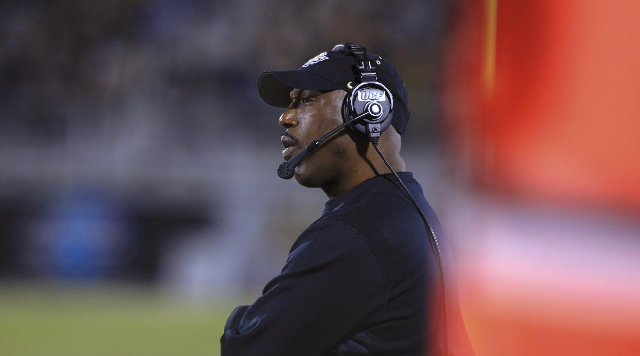 Central Florida coach Danny Barrett watches during the second quarter of his team's NCAA college football game against South Florida on Thursday, Nov. 26, 2015, in Orlando, Fla. (Joshua C. Cruey/Orlando Sentinel via AP)