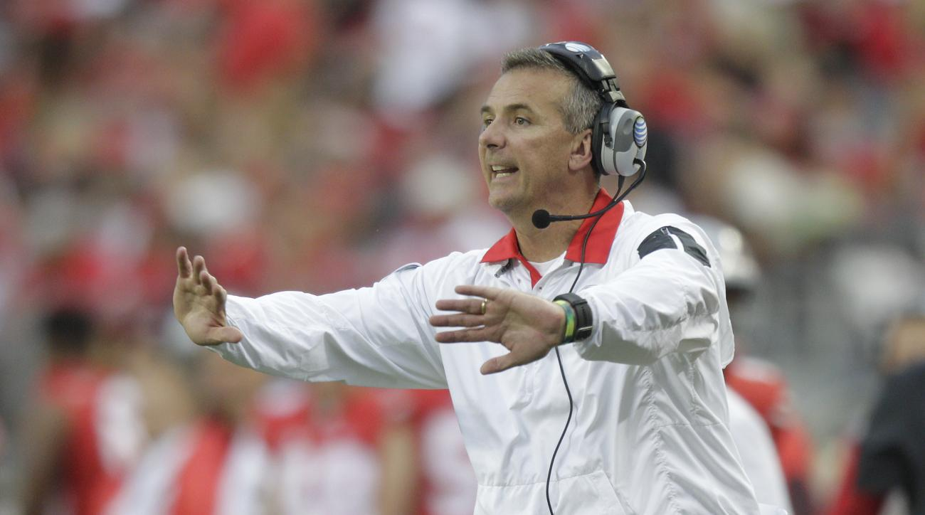 FILE - In this Sept. 26, 2015, file photo, Ohio State coach Urban Meyer motions near the sideline during an NCAA college football game against Western Michigan in Columbus, Ohio. Ohio State faces Michigan on Saturday, Nov. 28, in the first matchup of Meye