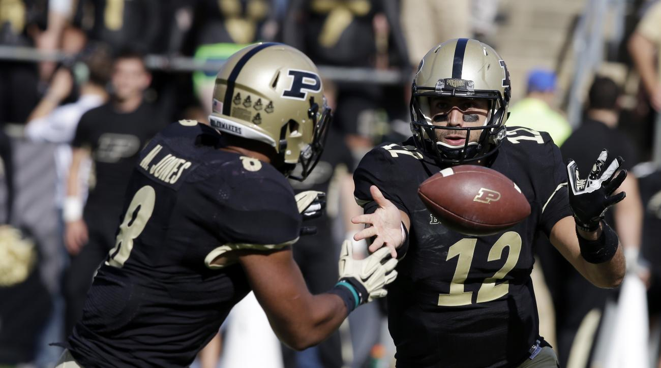 FILE - In this Sept. 19, 2015, file photo, Purdue's Austin Appleby (12) tosses the football to Markell Jones during an NCAA college football game against Virginia Tech in West Lafayette, Ind. Appleby is likely to reclaim the starting job he lost earlier t