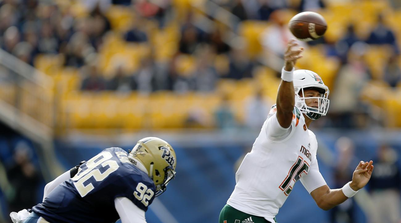 Miami quarterback Brad Kaaya (15) passes as Pittsburgh defensive lineman Rori Blair (92) pressures in the first quarter of an NCAA college football game, Friday, Nov. 27, 2015, in Pittsburgh. (AP Photo/Keith Srakocic)