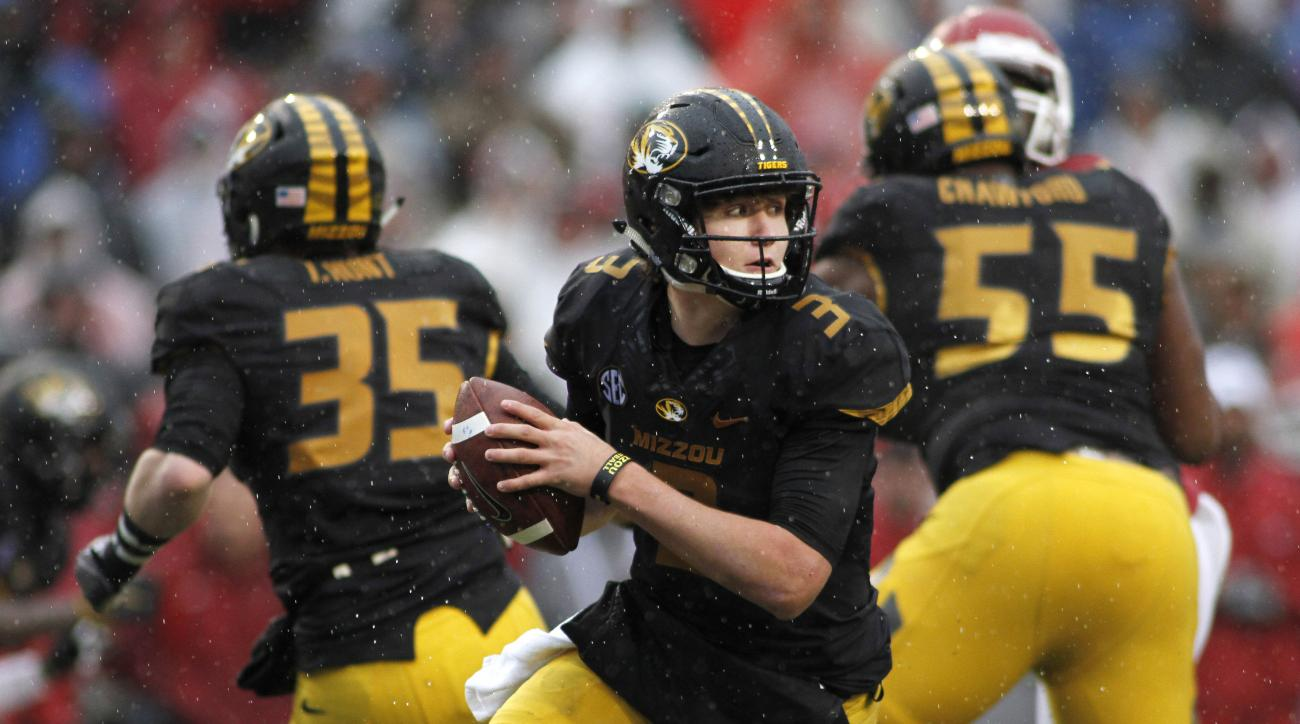 Missouri's Drew Lock (3) drops back to look for an open receiver during the first half of an NCAA college football game against Arkansas, Friday, Nov. 27, 2015, in Fayetteville, Ark.  (AP Photo/Samantha Baker)