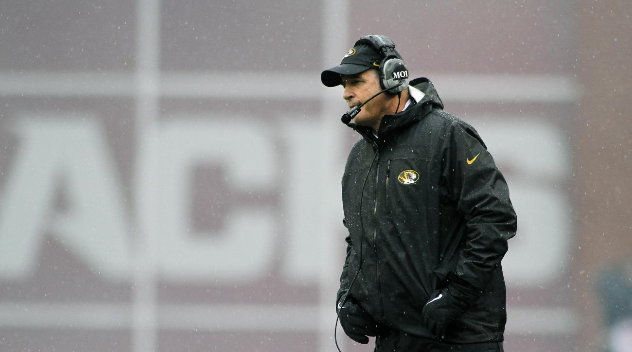 Missouri's Gary Pinkel watches from the sidelines during the first half of an NCAA college football game against Arkansas, Friday, Nov. 27, 2015, in Fayetteville, Ark.  (AP Photo/Samantha Baker)