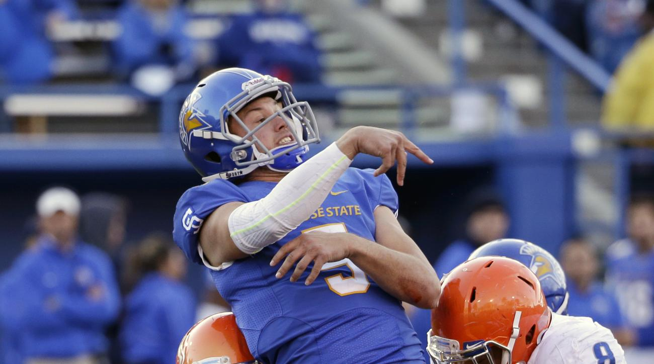 San Jose State quarterback Kenny Potter (5) throws under pressure from Boise State linebacker Joe Martarano (7) and defensive lineman Kamalei Correa (8) during the second half of an NCAA college football game Friday, Nov. 27, 2015, in San Jose, Calif. (AP