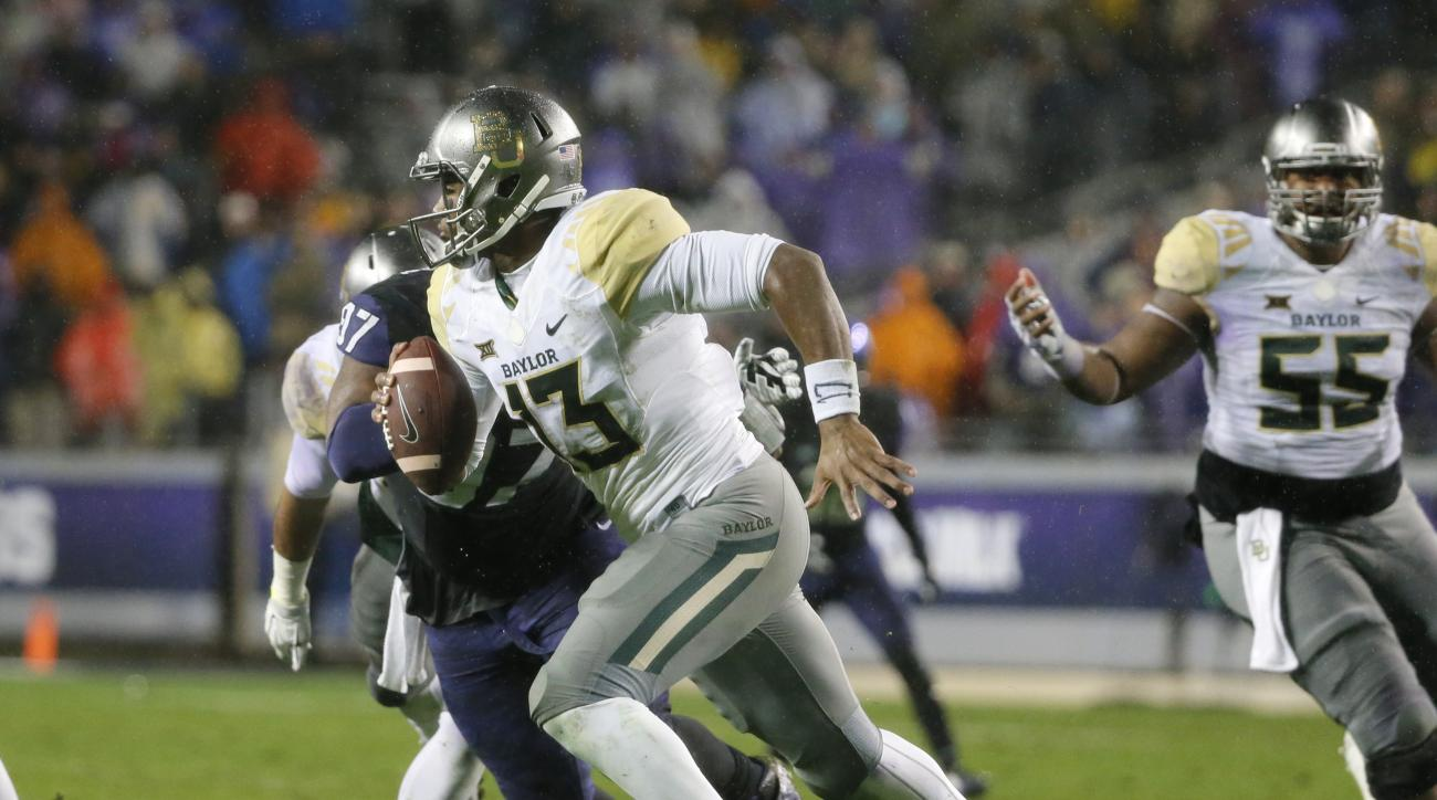 Baylor quarterback Chris Johnson (13) scrambles out of the pocket during the first half of an NCAA college football game against TCU, Friday, Nov. 27, 2015, in Fort Worth, Texas. (AP Photo/Tony Gutierrez)