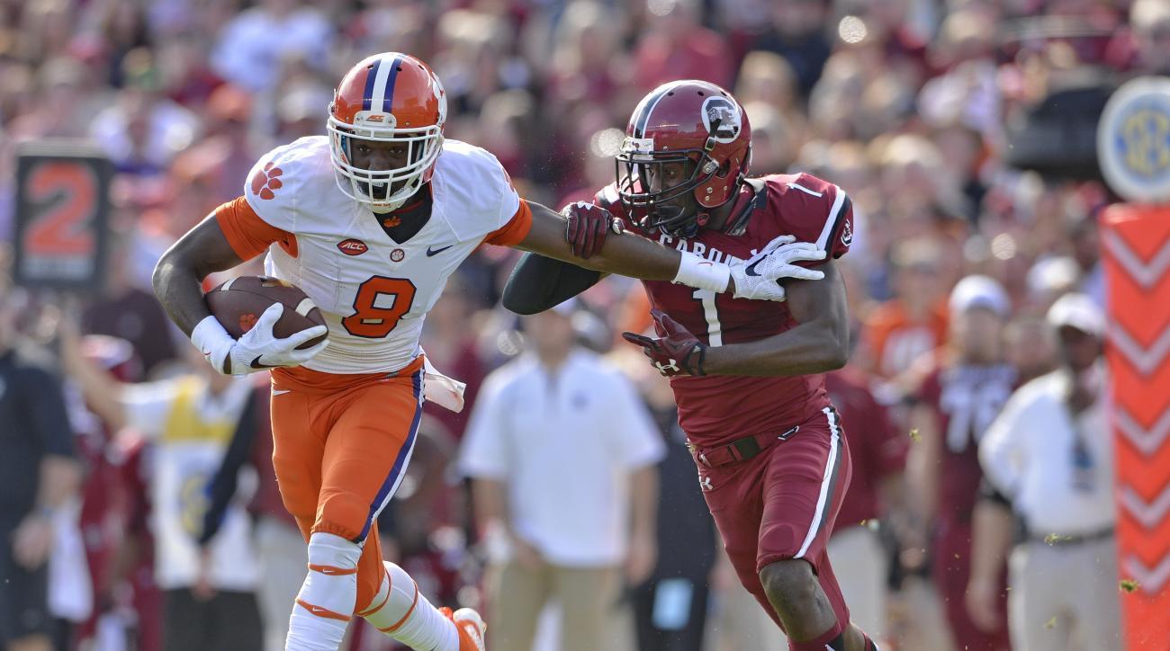 Clemson's Wayne Gallman runs through the tackle attempt of South Carolina's Rico McWilliams during the first half of an NCAA college football game Saturday,  Nov. 28, 2015,  in Columbia,  S.C. (AP Photo/Richard Shiro)