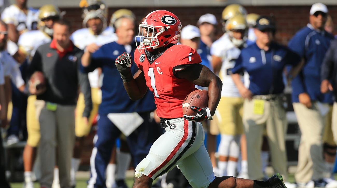 Georgia tailback Sony Michel sprints to the end zone for a touchdown against Georgia Tech during the first period of an NCAA college football game Saturday, Nov. 28, 2015, in Atlanta.  (Curtis Compton/Atlanta Journal-Constitution via AP)  MARIETTA DAILY O