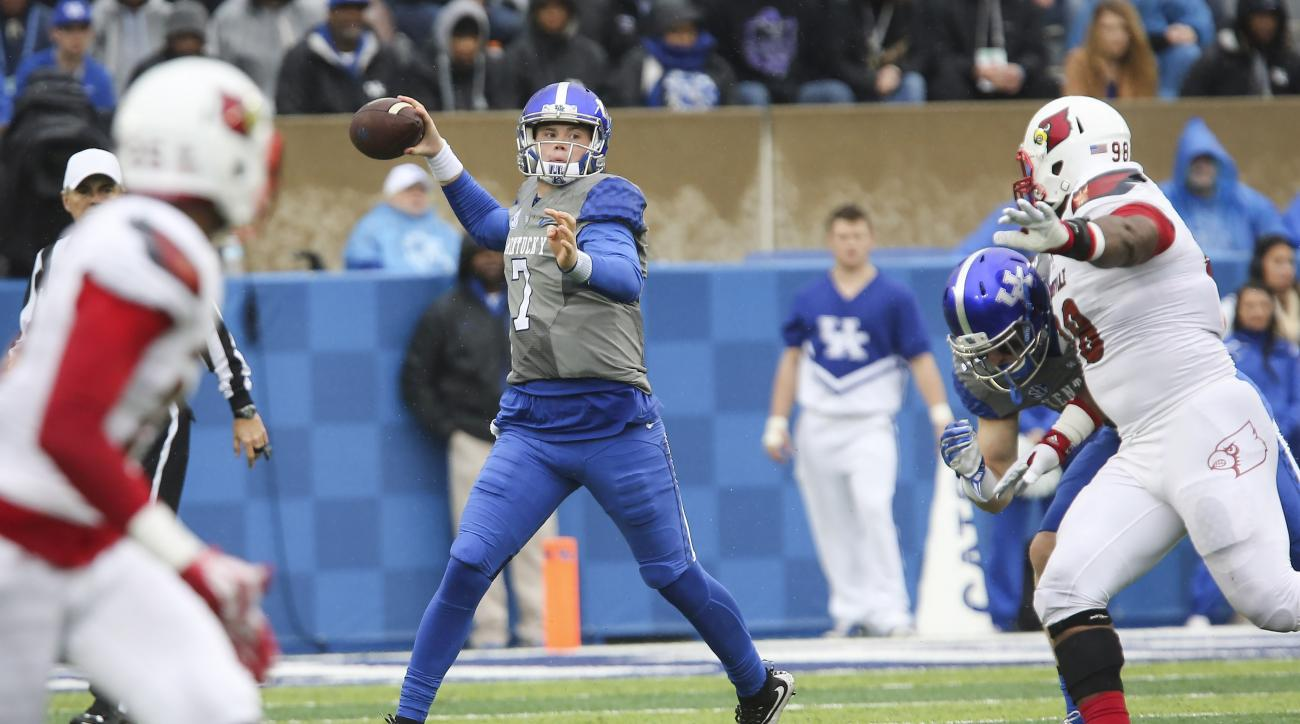 Kentucky quarterback Drew Barker throws downfield to a receiver during the first half of an NCAA college football game against Louisville, Saturday, Nov. 28, 2015, in Lexington, Ky. (AP Photo/David Stephenson)