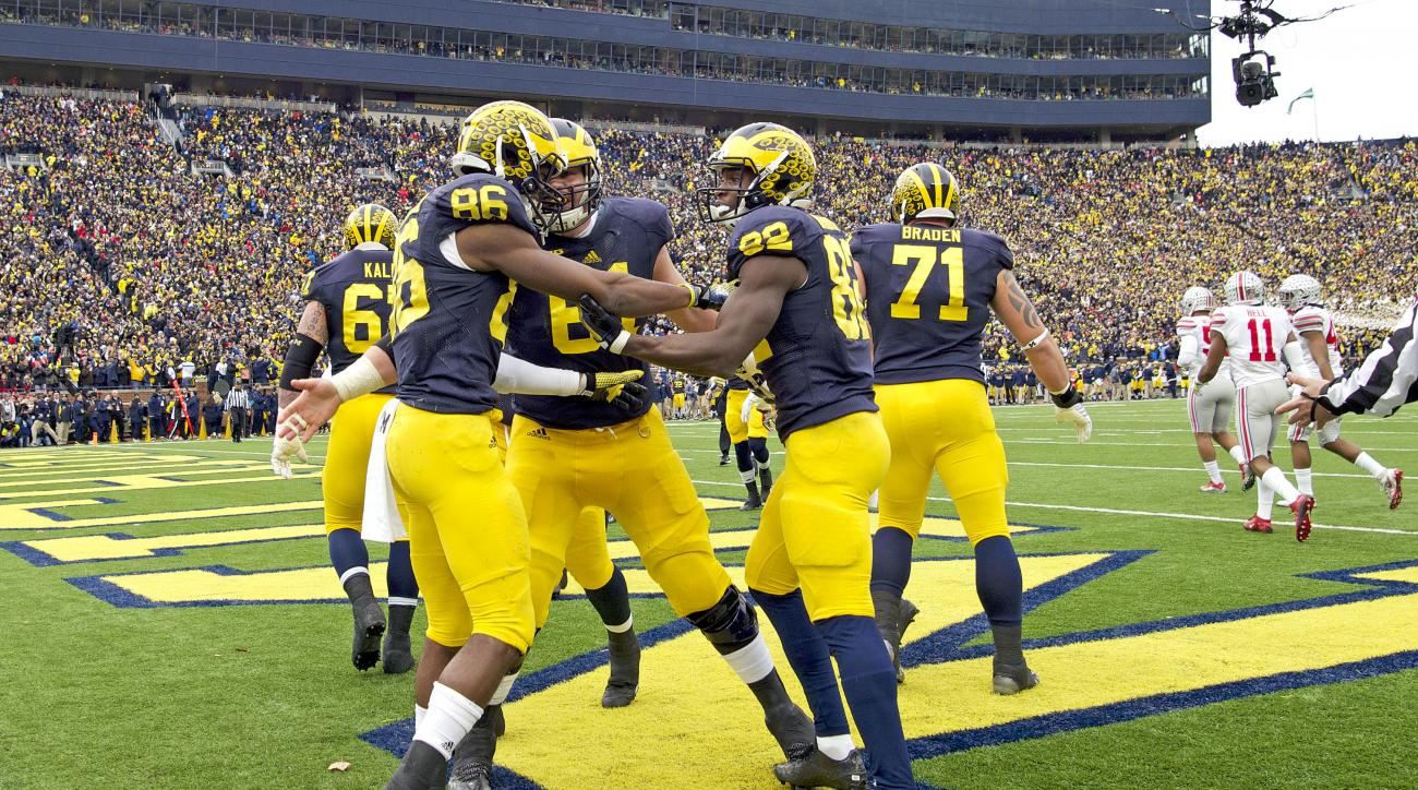 Michigan wide receiver Jehu Chesson (86) celebrates his touchdown with offensive lineman Graham Glasgow, center, and wide receiver Amara Darboh (82), in the second quarter of an NCAA college football game against Ohio State in Ann Arbor, Mich., Saturday,