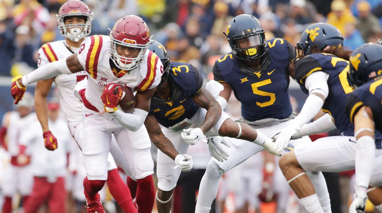Iowa State wide receiver Quenton Bundrage (9) is tackle by West Virginia linebacker Edward Muldrow (20) during the first half of an NCAA college football game, Saturday, Nov. 28, 2015, in Morgantown, W.Va. (AP Photo/Raymond Thompson)