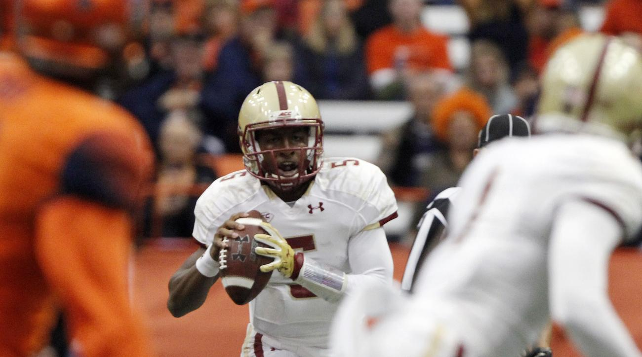 Boston College's Jeff Smith looks to pass the ball in the second quarter of NCAA college football game against Syracuse in Syracuse, N.Y., Saturday, Nov. 28, 2015. (AP Photo/Nick Lisi)