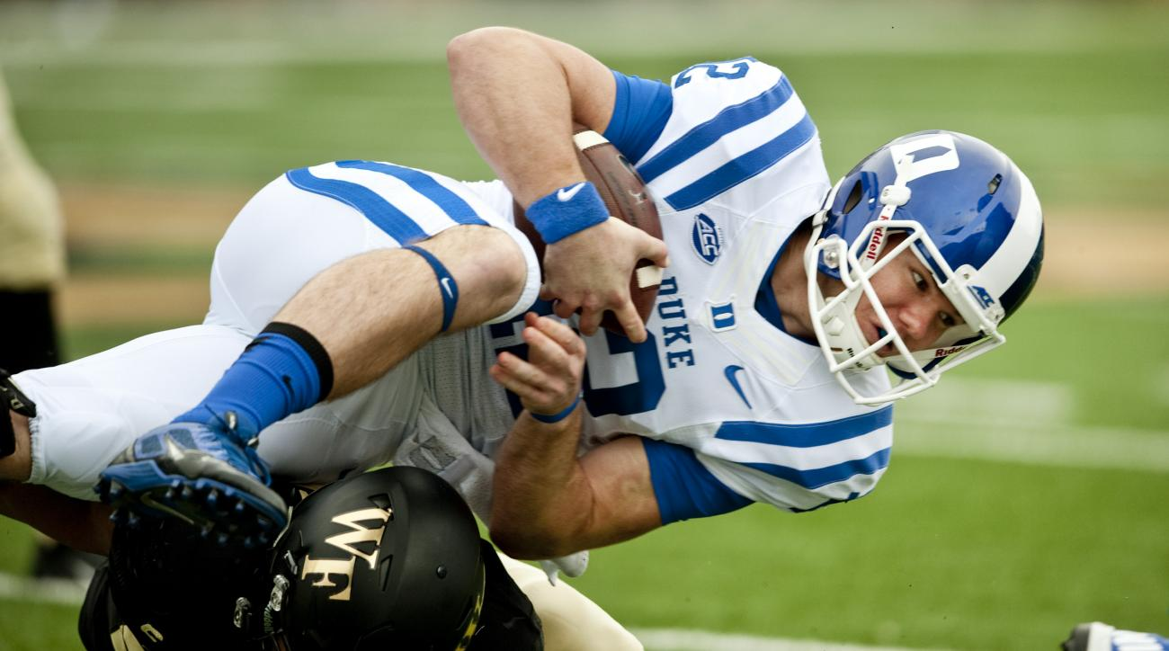 Duke quarterback Parker Boehme is taken down by Wake Forest defensive back Ryan Janvion during the first half of an NCAA college football game in Winston-Salem, N.C. Saturday, Nov. 28, 2015. (Lauren Carroll /The Winston-Salem Journal via AP) MANDATORY CRE