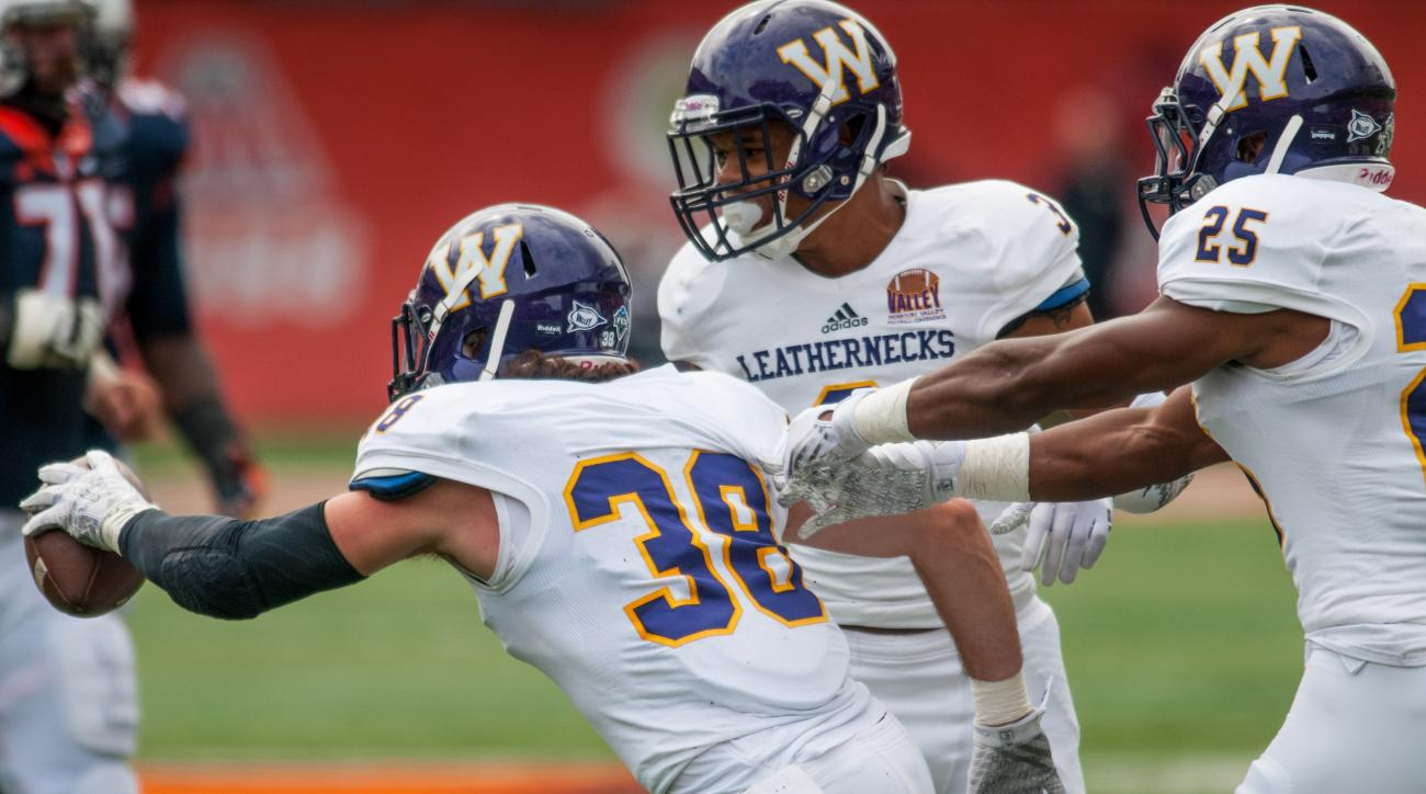 Western Illinois defensive back David Griffith (38) reacts after an interception during the first quarter of an NCAA college football game against Illinois, Saturday, Sept. 12, 2015, at Memorial Stadium in Champaign, Ill. (AP Photo/Bradley Leeb)
