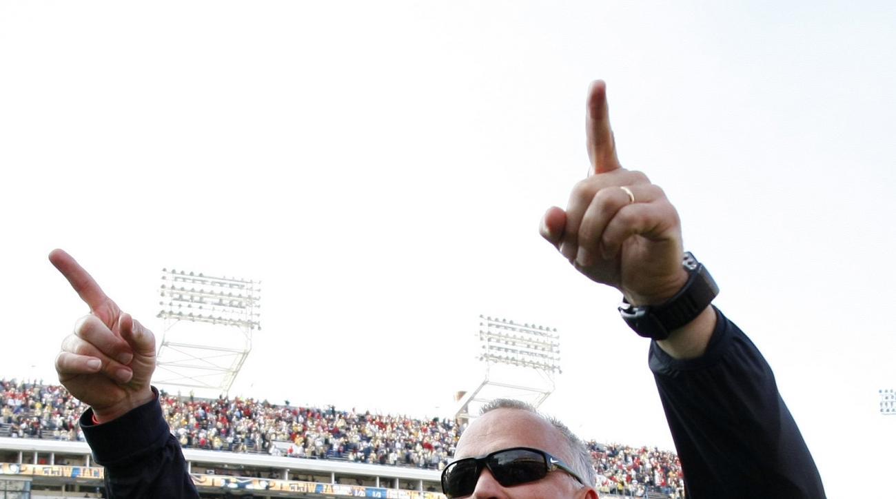 Georgia head coach Mark Richt celebrates as he walks off the field after they defeated Georgia Tech 13-7 in an NCAA college football game Saturday, Nov. 28, 2015, in Atlanta, Ga. (AP Photo/Brett Davis)