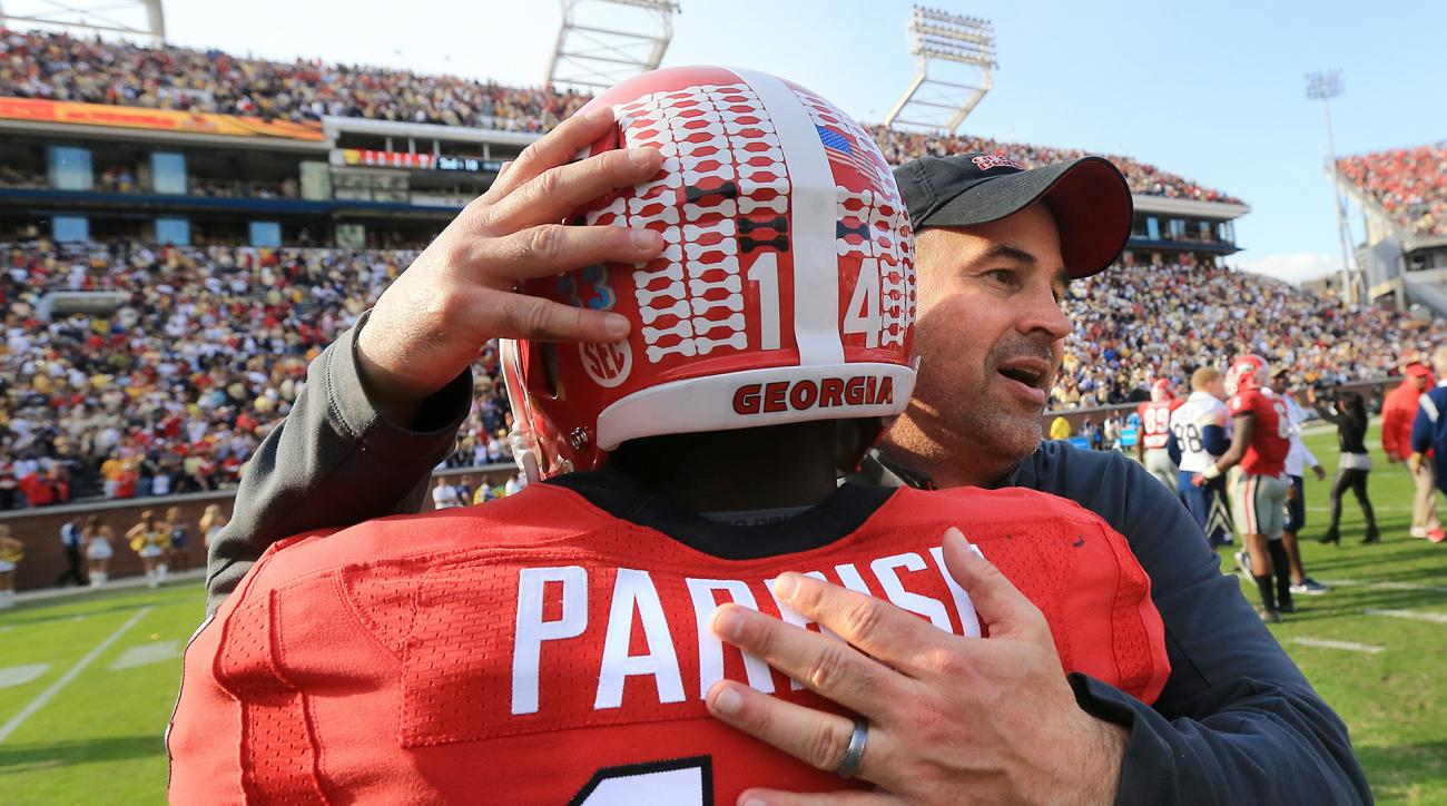 Georgia defensive coordinator Jeremy Pruitt hugs cornerback Malkom Parrish as they celebrate after their 13-7 win over Georgia Tech in an NCAA college football game Saturday, Nov. 28, 2015, in Atlanta. (Curtis Compton/Atlanta Journal-Constitution via AP)