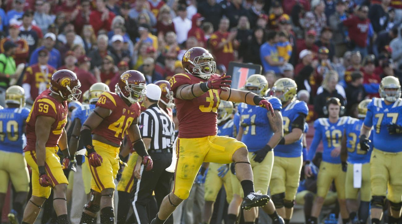 Southern California fullback Soma Vainuku, center, reacts to a play during the second half of an NCAA college football game against UCLA, Saturday, Nov. 28, 2015, in Los Angeles. USC won 41-20. (AP Photo/Jae C. Hong)