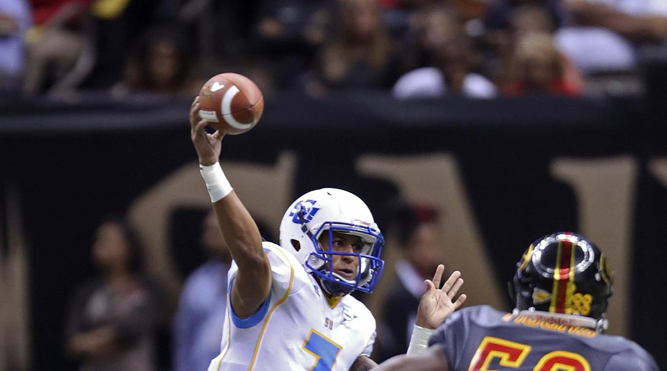 Southern University quarterback Austin Howard (7) throws a pass against Grambling State during the first half of the Bayou Classic NCAA college football game in New Orleans, Saturday, Nov. 28, 2015. (AP Photo/Max Becherer)