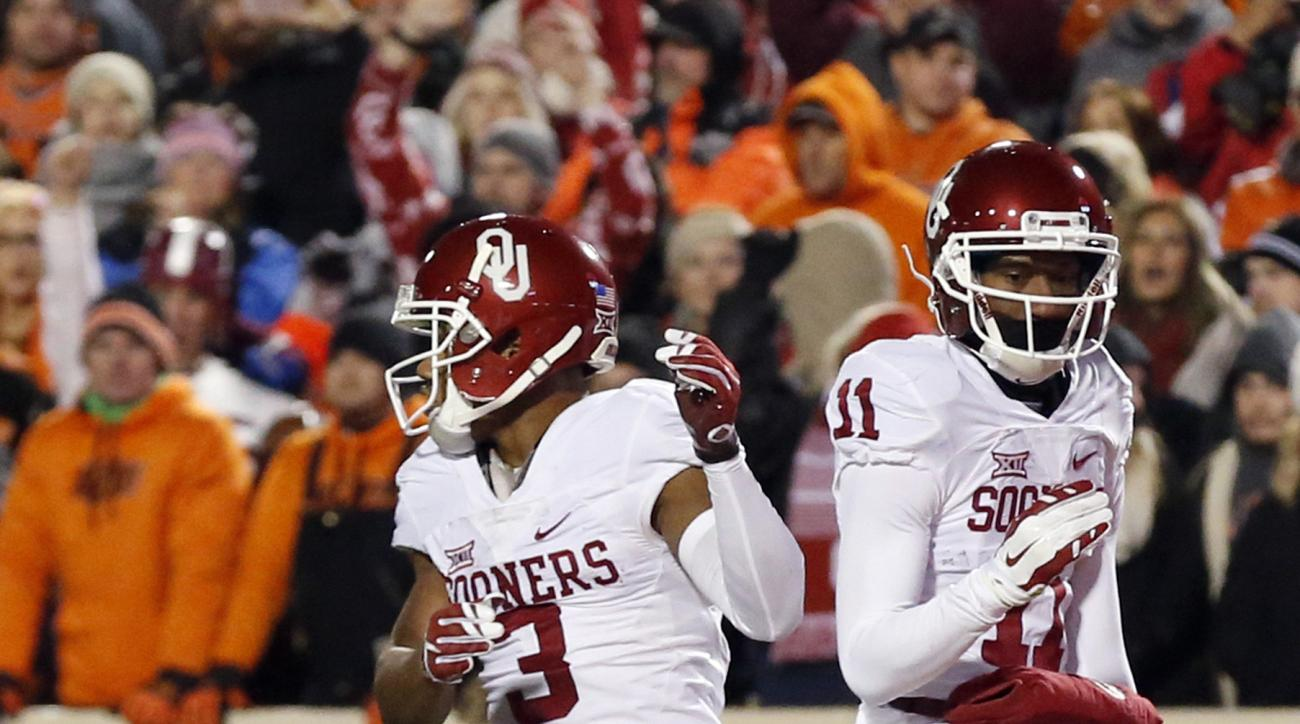 Oklahoma wide receiver Sterling Shepard (3) celebrates his touchdown with teammate Dede Westbrook (11) in the first quarter of an NCAA college football game against Oklahoma State in Stillwater, Okla., Saturday, Nov. 28, 2015. (AP Photo/Sue Ogrocki)