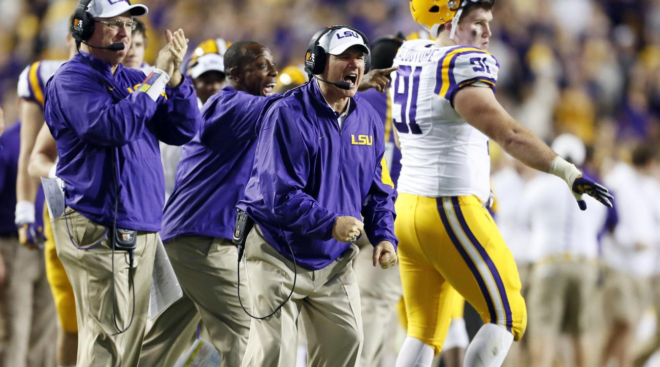 LSU head coach Les Miles reacts to LSU recovering a fumble during the first half an NCAA college football game against Texas A&M in Baton Rouge, La., Saturday, Nov. 28, 2015. (AP Photo/Jonathan Bachman)