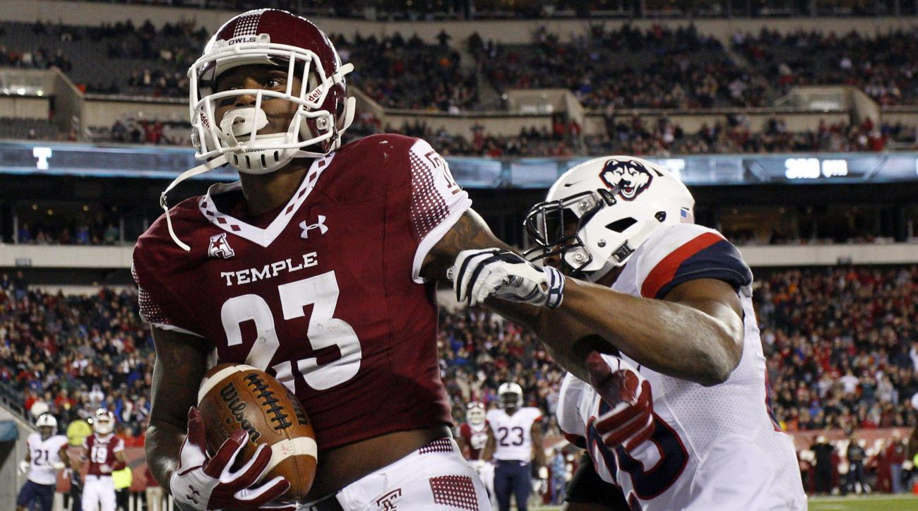 Temple wide receiver Romond Deloatch (23) reacts to his touchdown catch over Connecticut safety Obi Melifonwu (20) during the second half of an NCAA college football game, Saturday, Nov. 28, 2015, in Philadelphia. (AP Photo/Chris Szagola)