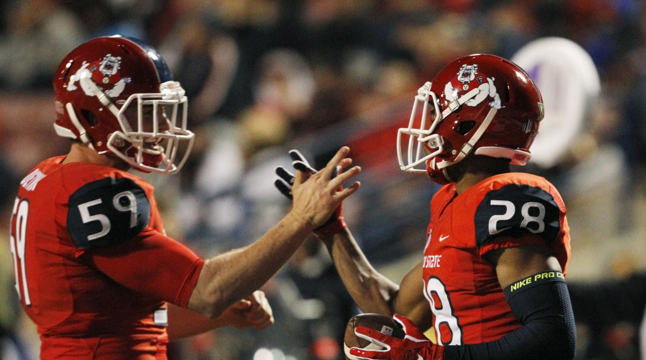 Fresno State's Dylan Detwiler, left, and Charles Washington celebrate after a special teams play against Colorado State during the first half of an NCAA college football game in Fresno, Calif., Saturday, Nov. 28, 2015. (AP Photo/Gary Kazanjian)