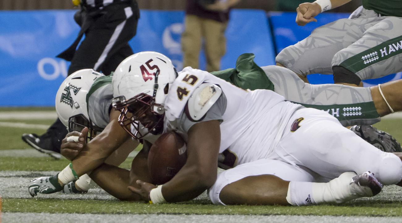 Louisiana Monroe defensive lineman Lorenzo Jackson (45) gains control of a fumble from Hawaii running back Ryan Tuiasoa (48) late in the fourth quarter of an NCAA college football game and score a touch down, Saturday, Nov. 28, 2015, in Honolulu. Hawaii b