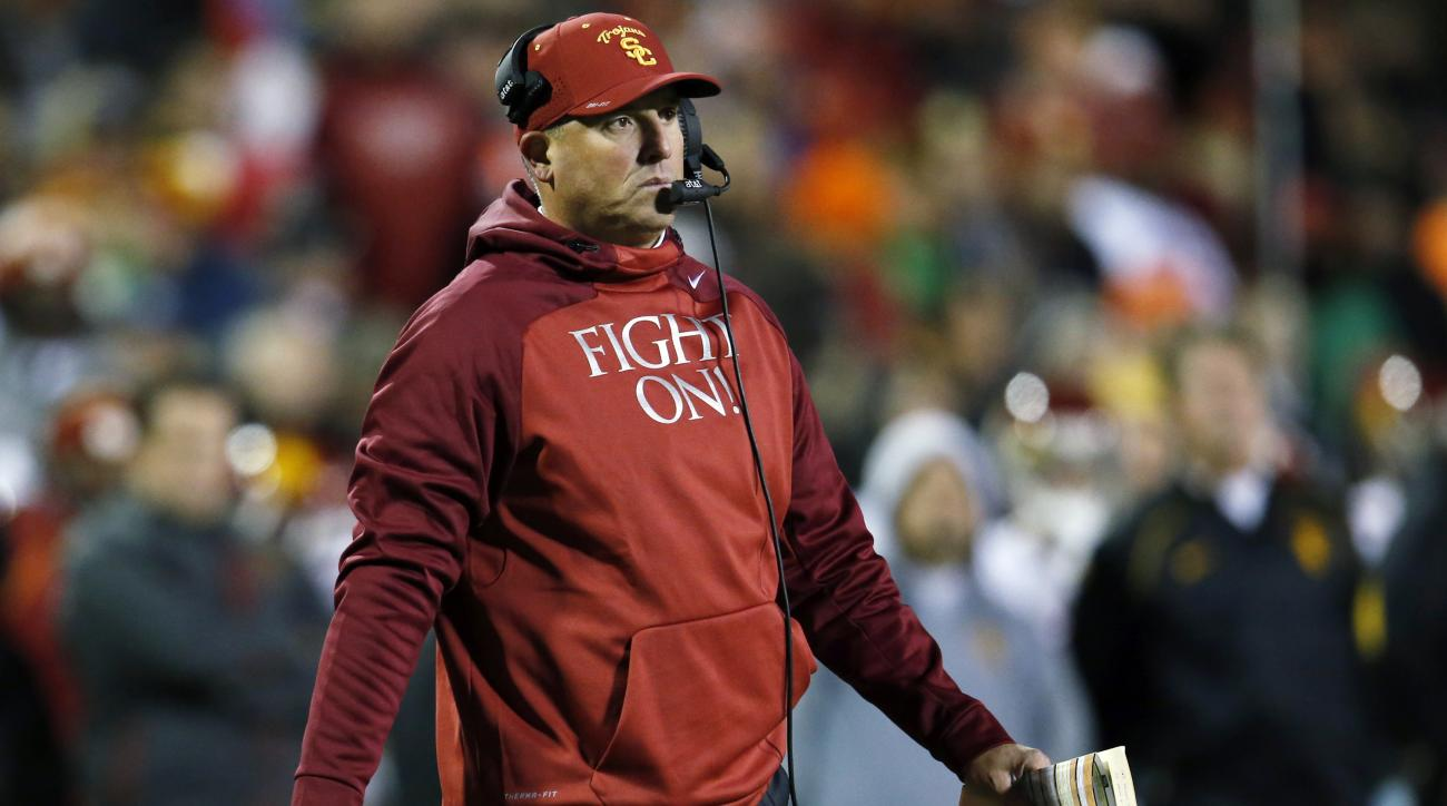 FILE - In this Friday, Nov. 13, 2015, file photo, Southern California head coach Clay Helton roams the sideline in the second half of an NCAA college football game against Colorado, in Boulder, Colo. Southern California hired Helton as its permanent coach