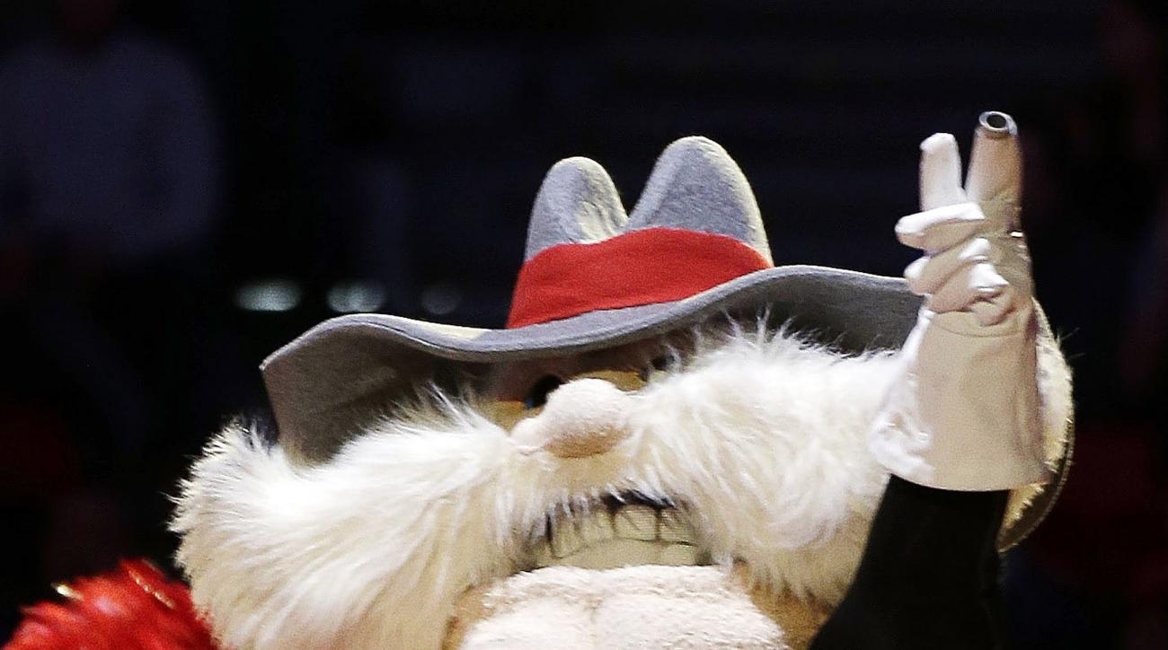 """FILE - In this Feb. 1, 2014, file photo, UNLV mascot Hey Reb warms up the crowd before an NCAA college basketball game in Las Vegas. UNLV President Len Jessup says the school needs to keep """"Rebels"""" as its nickname after new research concluded it is not a"""