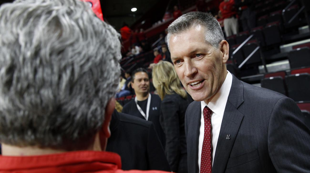 Rutgers new athletic director Patrick Hobbs, Dean Emeritus of the Seton Hall University School of Law, greets a Rutgers fan before an NCAA college basketball game against Wake Forest, Monday, Nov. 30, 2015, in Piscataway, N.J. Rutgers fired football coach