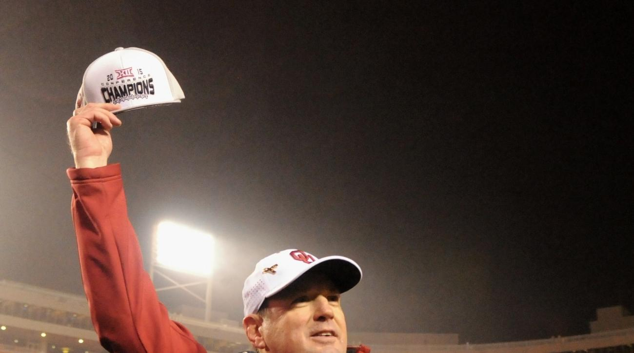 FILE - In this Nov. 28, 2015, file photo, Oklahoma head coach Bob Stoops holds up a Big 12 Champions hat following a 58-23 win over Oklahoma State in an NCAA college football game in Stillwater, Okla. No. 3 Oklahoma has already clinched its ninth Big 12 t