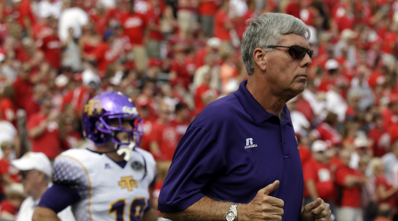 Tennessee Tech head coach Watson Brown runs onto the field for the first half of an NCAA college football game against Wisconsin Saturday, Sept. 7, 2013, in Madison, Wis. (AP Photo/Morry Gash)