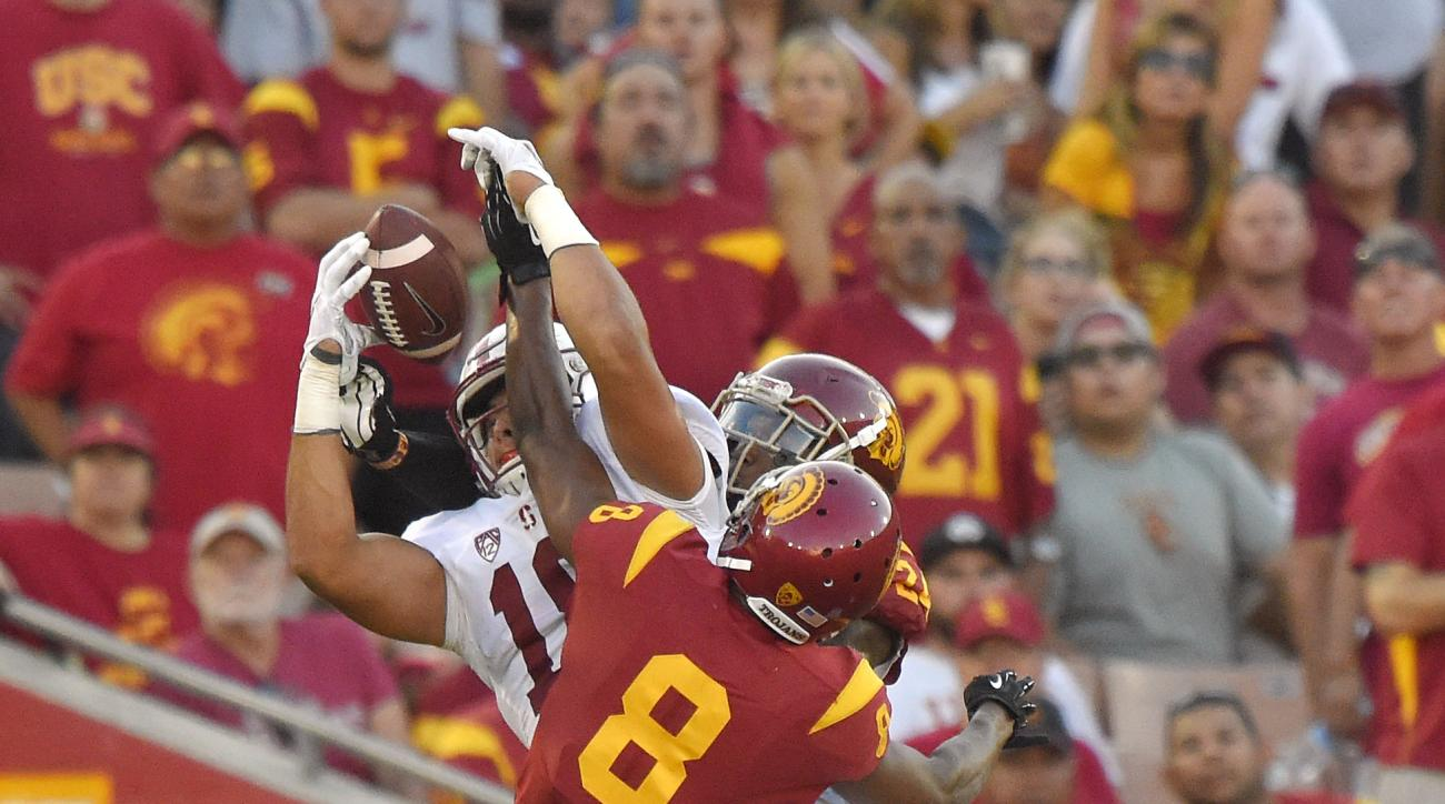 FILE - In this Sept. 19, 2015 file photo, Stanford tight end Austin Hooper, left, makes a catch near the end zone under pressure from Southern California cornerback Iman Marshall (8) and safety John Plattenburg during the first half of an NCAA college foo