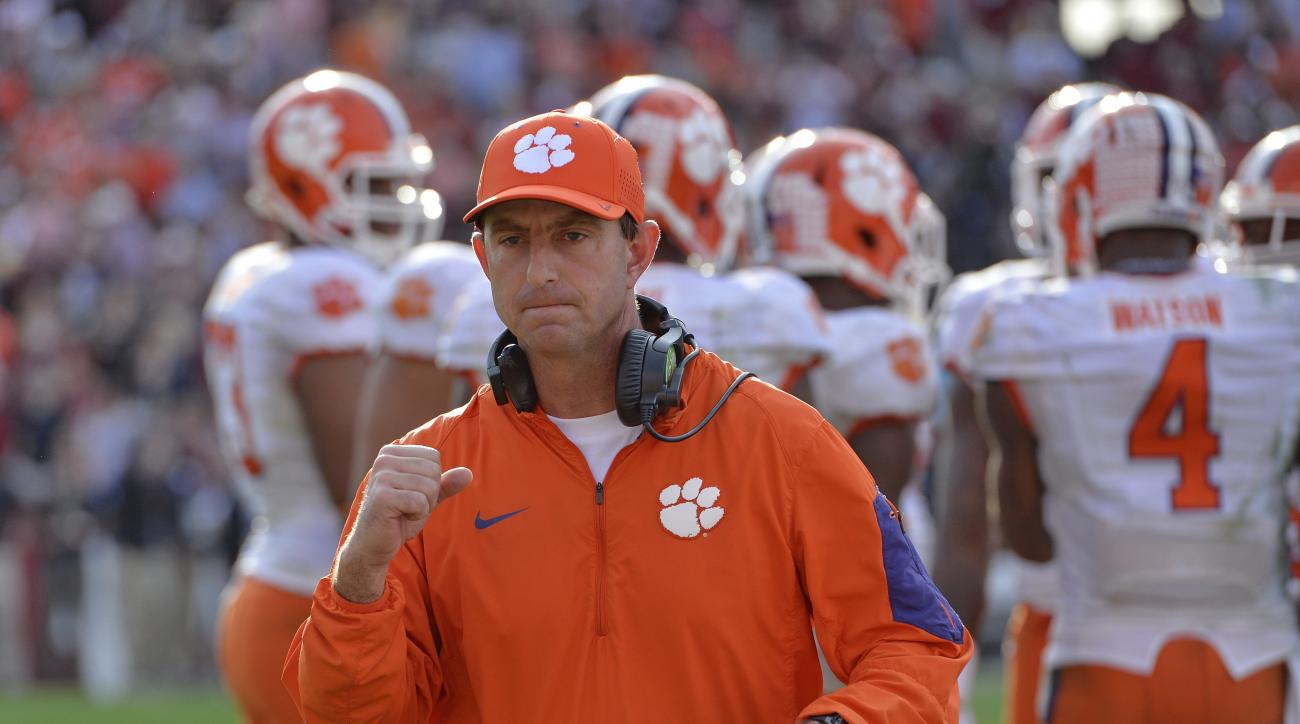 FILE - In this Nov. 28, 2015 file photo, Clemson head coach Dabo Swinney reacts in the closing minutes of an NCAA college football game against South Carolina in Columbia,  S.C.  Swinney is three victories away from winning a national championship. (AP Ph