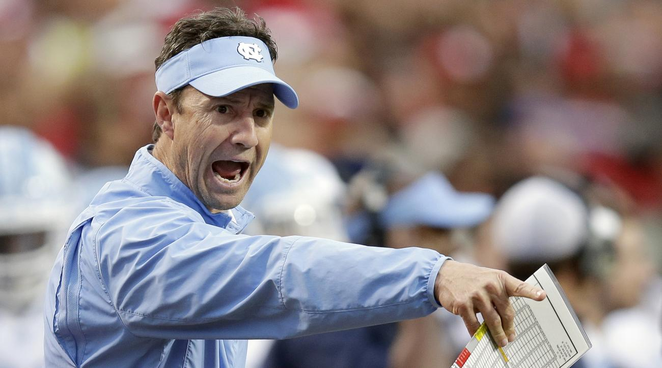 FILE - In this Nov. 28, 2015 file photo, North Carolina coach Larry Fedora yells at an official during the first half an NCAA college football game against North Carolina State in Raleigh, N.C.  Fedora is in his fourth season and has guided the No. 8 Tar