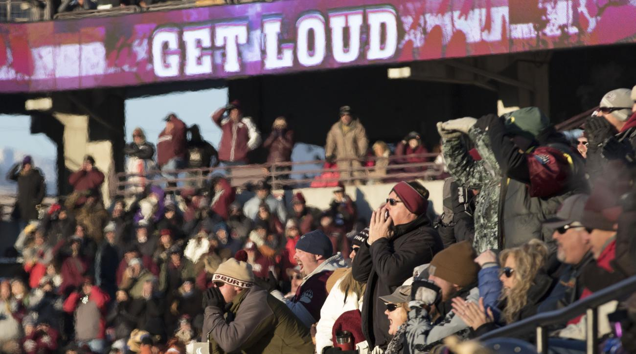 Montana fans make some noise while playing against South Dakota State during the second half of the first round game of the NCAA college Football Championship Subdivision playoff, Saturday, Nov. 28, 2015, in Missoula, Mont. Montana defeated South Dakota S