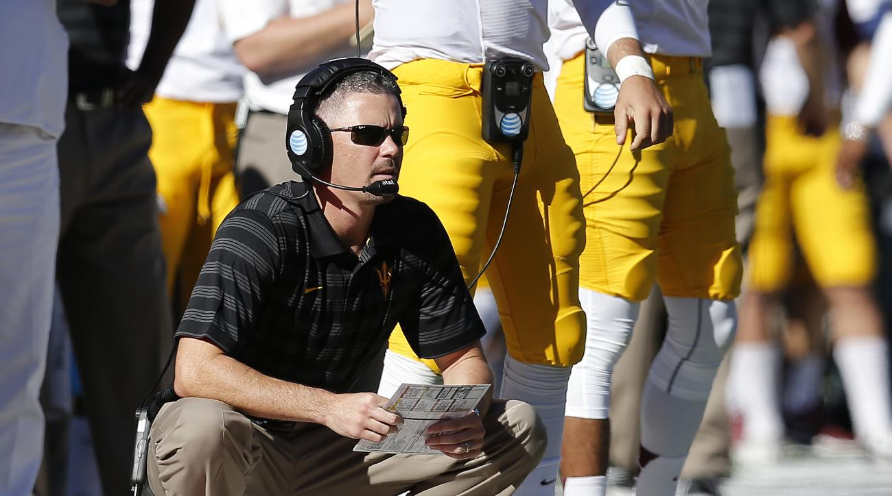 FILE - In this Nov. 28, 2014, file photo, Arizona State offensive coordinator Mike Norvell watches from the sidelines during the second half of an NCAA college football game against Arizona in Tucson, Ariz. A person with direct knowledge of the decision t