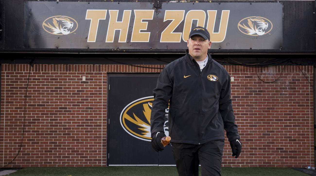 Missouri defensive coordinator Barry Odom walks on the field before the start of their NCAA college football game against Tennessee Saturday, Nov. 21, 2015, in Columbia, Mo. (AP Photo/L.G. Patterson)
