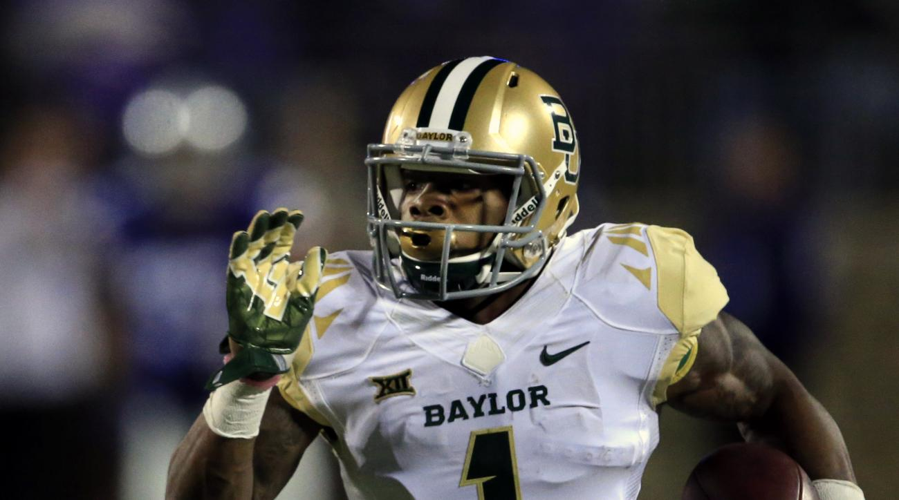 FILE - In this Nov. 5, 2015, file photo, Baylor wide receiver Corey Coleman runs for a touchdown during an NCAA college football game against Kansas State in Manhattan, Kan. Coleman is the FBS leader with 20 touchdown catches. Baylor plays Texas on Saturd