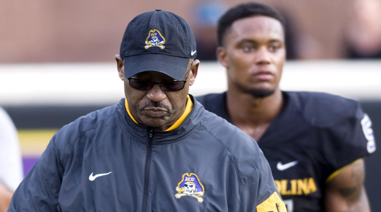 FILE - In this Nov. 28, 2015, file photo, East Carolina head coach Ruffin McNeill ends the season with a loss to Cincinnati, at Dowdy-Ficklen Stadium in Greenville N.C. East Carolina fired coach Ruffin McNeill after six seasons, athletic director Jeff Com