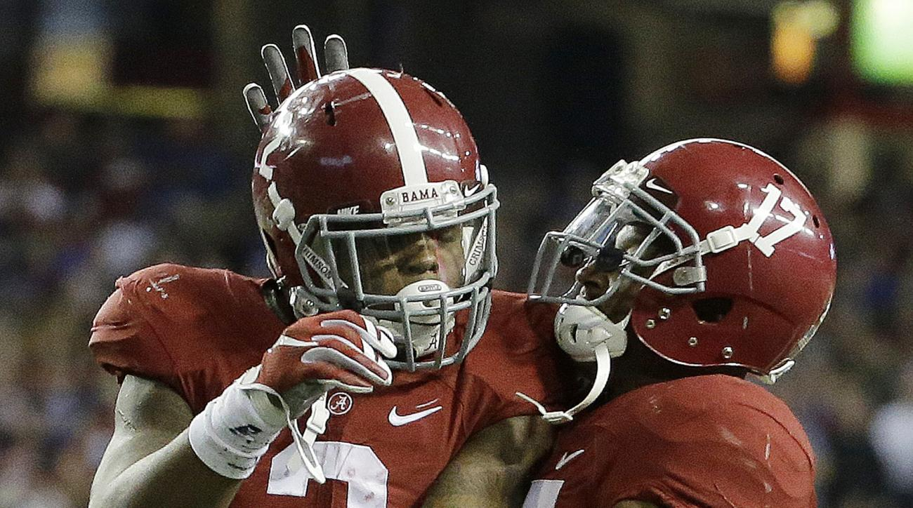 Alabama running back Derrick Henry (2) celebrates his touchdown run against Florida with Alabama running back Kenyan Drake (17) during the first half of the Southeastern Conference championship NCAA college football game, Saturday, Dec. 5, 2015, in Atlant