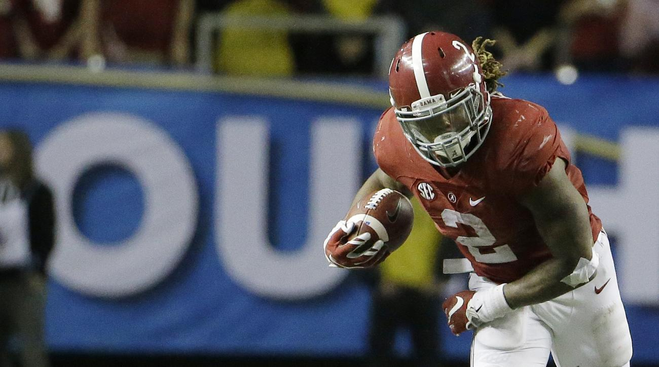 Alabama running back Derrick Henry (2) leaps over Florida defensive back Jalen Tabor (31) during the second half of the Southeastern Conference championship NCAA college football game, Saturday, Dec. 5, 2015, in Atlanta. (AP Photo/David Goldman)