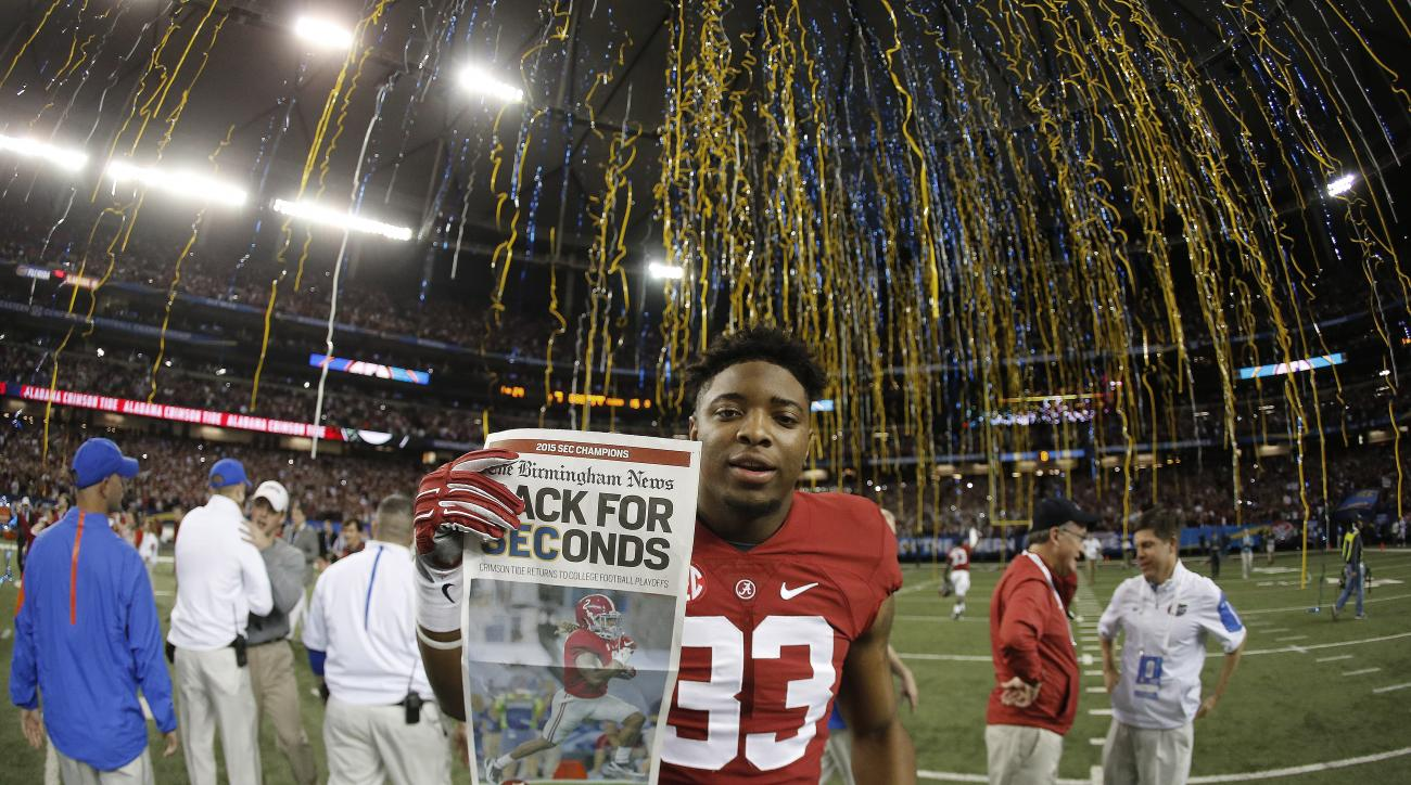 Alabama linebacker Anfernee Jennings (33) celebrates after the second half of the Southeastern Conference championship NCAA college football game between Alabama and Florida, Saturday, Dec. 5, 2015, in Atlanta. Alabama won 29-15. (AP Photo/John Bazemore)