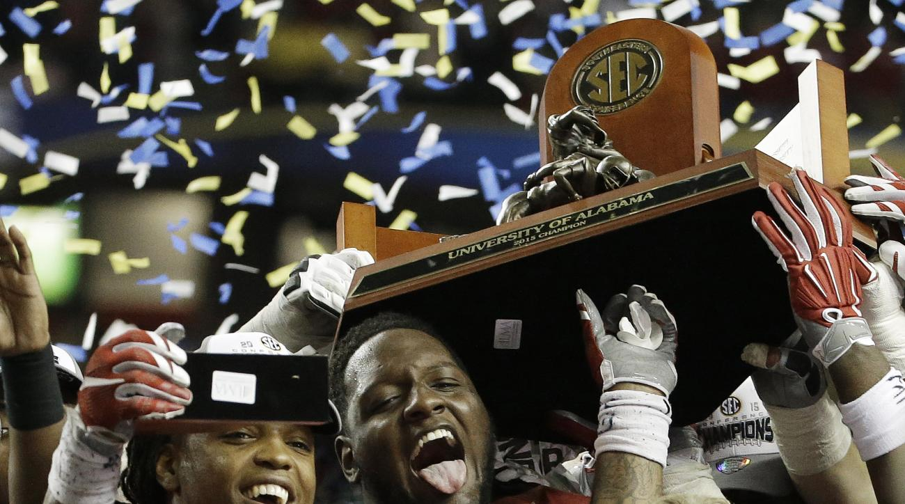 Alabama running back Derrick Henry (2) and Alabama head coach Nick Saban celebrate after the second half of the Southeastern Conference championship NCAA college football game against Florida, Saturday, Dec. 5, 2015, in Atlanta. Alabama won 29.15. (AP Pho