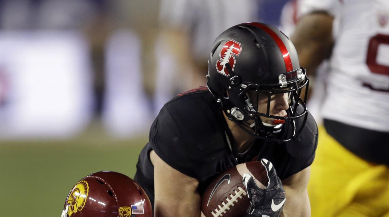 Stanford's Christian McCaffrey, top, is tackled by Southern California's Chris Hawkins (4) during the first quarter of a Pac-12 Conference championship NCAA college football game Saturday, Dec. 5, 2015, in Santa Clara, Calif. (AP Photo/Ben Margot)